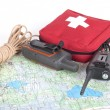 Map, gps navigator, portable radio, rope and first aid kit on a  — Stock Photo #69499075