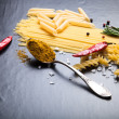 Different kinds of pasta, red chili pepper, rosemary, sea salt a — Stock Photo #70740403