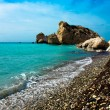 Pebble beach and blue sea in the Aphrodites birthplace. Paphos, — Stock Photo #71961119
