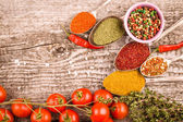 Bunch of cherry tomatoes, herbs, small bowl and antic metal spoo — Stock Photo