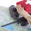 Map, gps navigator, portable radio, rope and first aid kit on a  — Stock Photo #73575613