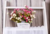 Artificial flowers in the basket — Stockfoto
