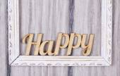 Word happy in the frame — Stockfoto