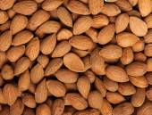 Peeled almonds background — Stock Photo
