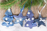 Christmas trees and stars on a fir branch  — Stock fotografie