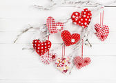 Heart of fabric on a snowy branch — Stock Photo