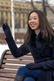 Happy Asian woman a friendly wave of his hand — Foto de Stock