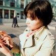 Girl dials the number on the mobile phone. — Stock Photo #73816243