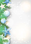 Christmas background with green branches and blue ornaments — Stockvektor
