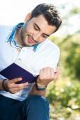 Close up man reading book, — Stock Photo