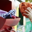 Woman Recycling Clothes At Clothing Bank — Stock Photo #61871805