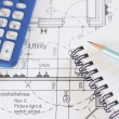 Calculator, Notepad And Pencil Arranged On House Plans — Stock Photo #61876563