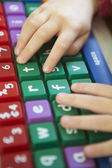 Child's Hand Typing On Colourful Computer Keyboard — Stock Photo