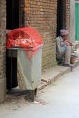 A Nepalese man waiting for customers to buy his poultry — Stock Photo