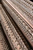 Details of wooden entrance carved in skulls — Stock Photo