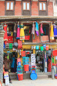 Cookware, plastic utensils and clothes for sale in Kathmandu, Nepal — Stock Photo