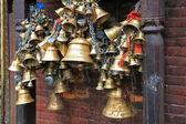 Metal sacrificial bells hanging on chain at Kumbeshwar Temple — Stok fotoğraf