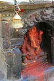 A brass bell in front of a Ganesha Hindu shrine in Kathmandu, Nepal — Stock Photo