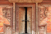 Crafted wooden doorframe and wall decoration in Kathmandu Durbar Square, Nepal — Stock Photo