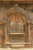 Stone door frame showing mythical creatures in Patan, Nepal — Stock Photo
