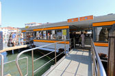 Water taxi or Water bus (Vaporetto) at the pier in Venice, Italy — Stock Photo