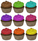 Coloridos cupcakes — Vector de stock
