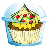 A cupcake inside the container — Vector de stock