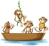 Monkeys on boat — Stock Vector