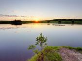 Sunrise over lake — Stock Photo