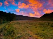 Sunset in hills — Stock Photo