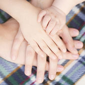 Four hands of the family together. — Stock Photo