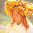 Autumn woman with crown of fall maple leaves — Stock Photo #55575939