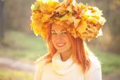 Autumn woman with crown of fall maple leaves — Stock Photo