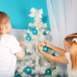 Kids decorating Christmas tree. — Stock Photo #55623933