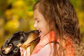 Little kid kissing dachshund puppy.  — Stock Photo