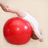 Baby playing sports with fitness ball.  — ストック写真