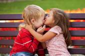 Couple of kids loving each other hugging — Stock fotografie