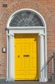 Yellow Georgian door in Dublin Ireland — Stock Photo