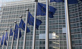 European flags in front  the Berlaymont building, headquarters  commission on Brussels. — Stock Photo