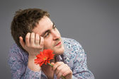 Portrait of man holding red flower  — Stock Photo