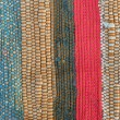 Motley rug textile fabrics texture closeup — Stock Photo #69791865