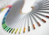 Colorful pencils arranged in a wave isolated over white  background — Stock Photo