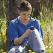 Teenager and mobile phone — Stock Photo #70679457