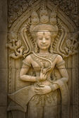 Apsara sculptures at Angkor Wat,detail of stone carvings  — Stock Photo