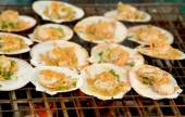 Grilled scallops topped with butter, garlic and onion  — Stock Photo