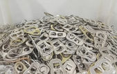 Pile of aluminium ring pull caps — Stock Photo