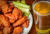 Buffalo Wings with Celery Sticks and Beer — Stock Photo