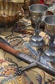 Swords and stemware — Stock Photo