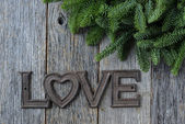 Love for Christmas Text with Pine Branches — Stock Photo