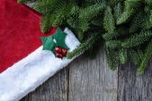 Pine Tree Branches and Santa Hat — Stock Photo